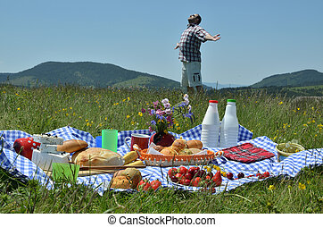 Man on Picnic Spreading His Arms