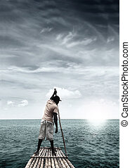 Man on raft in the middle of a tropical ocean paradise with dramatic sky