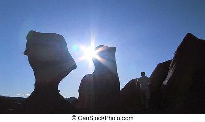 Man on rock in silhouette