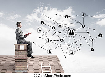 Man on roof reading book and concept of social connection