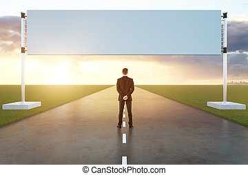 Man on runway with poster