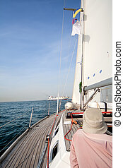 Man on sailing boat in the sea
