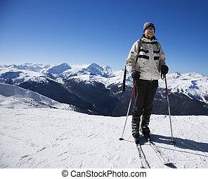 Man on ski slopes. - Caucasian senior man skier on slopes.
