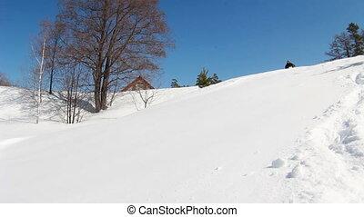 Man on snowmobile in winter