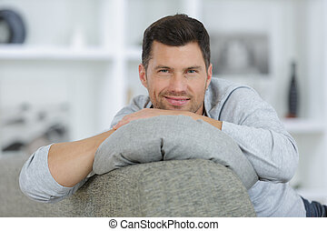 man on sofa using laptop