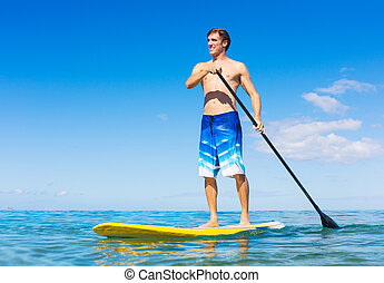 Man on Stand Up Paddle Board - Attractive Man on Stand Up...