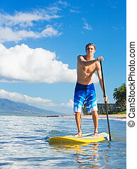 Man on Stand Up Paddle Board - Young Attractive Mann on...