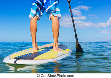 Man on Stand Up Paddle Board - Young Attractive Mann on ...