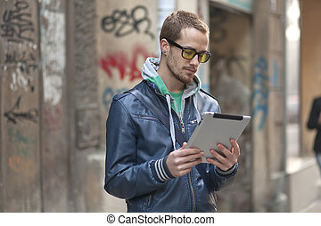 Man On Street Use Ipad Tablet Computer - Young man with...