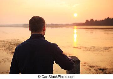 Man on sunrise background