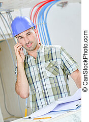 Man on telephone at construction site