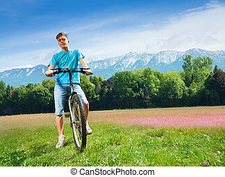 Man on the bike on the field