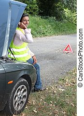 Man on the phone after a car breakdown