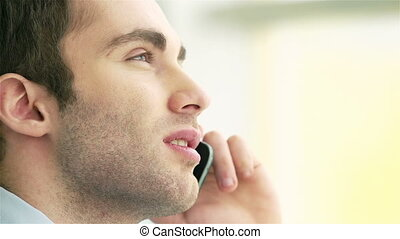 Man on the phone - Handsome man speaking on the phone
