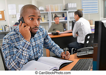 man on the phone with surprise facial expression