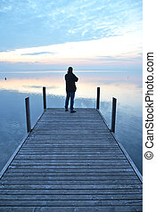 Man on the pier. Lake of Zug, Switzerland