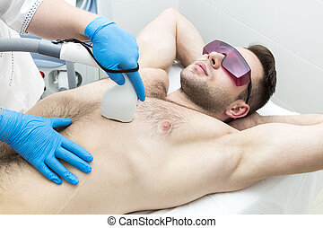 Man on the procedure of laser hair removal in the beauty salon