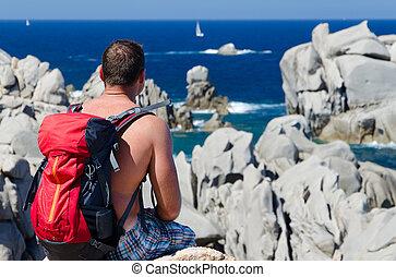 man on the rock in capo testa sardegna