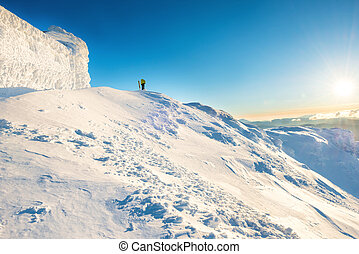 Man on the top of the winter mountain