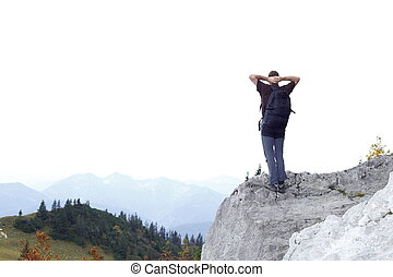 man on top of a rock