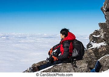 Man on top of mountain,Landscape in winter