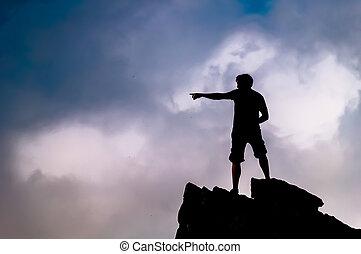 Man on top of rocks on Little Stony Man Mountain in ...
