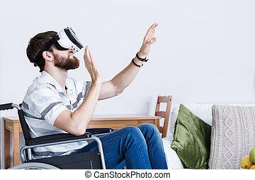 Man on wheelchair in VR