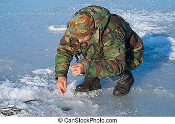Man on winter fishing 28