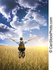 Man on yellow wheat meadow.