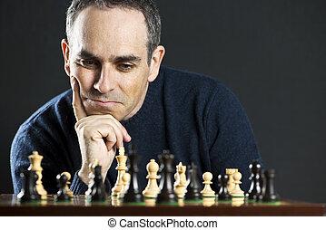 man, op, schaakspel bord