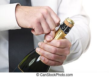 man open champagne bottle