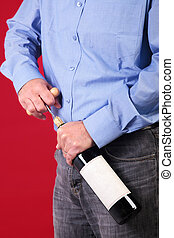 Man opening a bottle of red wine
