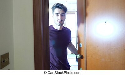 Man opening door and inviting