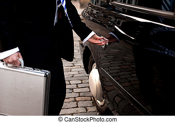 Man opening door of taxi cab - Cropped image of a male...