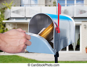 Man opening his mailbox to remove mail inside close up of ...