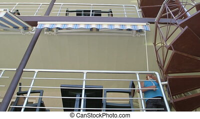 Man opening manual operation retractable awning against the...