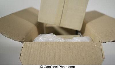 Man opening parcel cardboard box