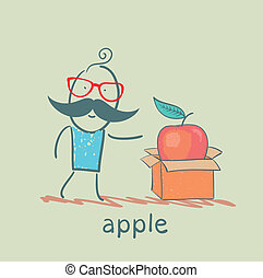 man opens a box with an apple