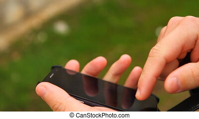 man opens Case smartphone and uses it HD