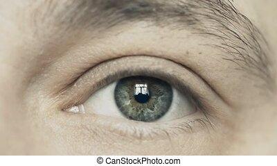 Man opens his eye, extreme close-up - Man opening his eye,...