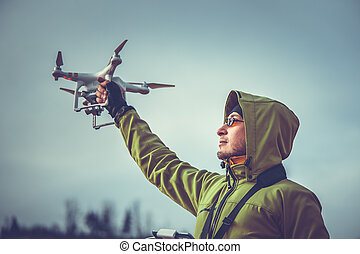Man operating a drone