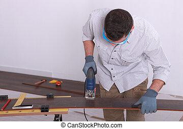Man operating a jigsaw