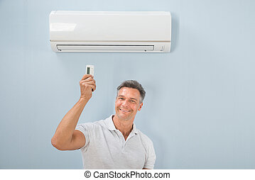 Man Operating Air Conditioner