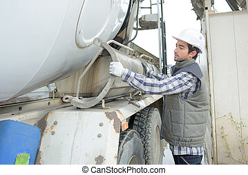 Man operating cement lorry