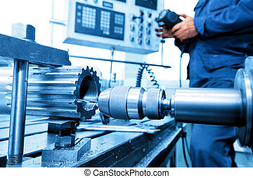 Man operating CNC drilling and boring machine. Industry