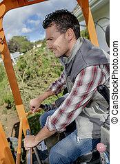 Man operating digger