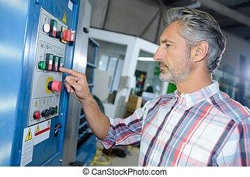 Man operating factory machine