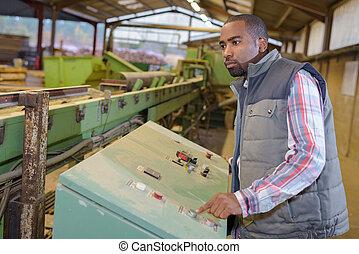 man operating machine at factory