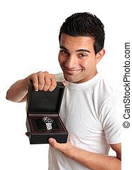 Man or salesman advertising a wristwatch - A friendly man or...