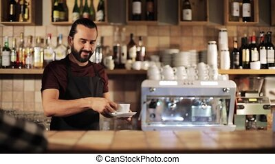 man or waiter serving customer in coffee shop - small...